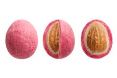 Pink sugared almond dragees isolated on white background stock photo