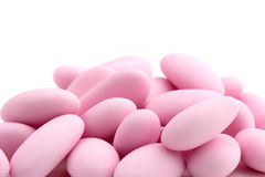 Pink sugared almonds stock images