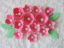 Pink sugary flowers. Different shape pink  artificial sugary flowers on coconut shavings Stock Photos