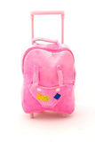 Pink suitcase. A cute little pink travel suitcase for kids going on holidays. Image isolated on white studio background Stock Images