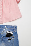 Pink summer blouse with ripped denim shorts Stock Photography