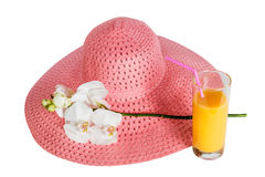 Pink summer hat, glass of orange juice  and white orchid isolated Royalty Free Stock Images