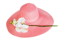 Pink summer hat  and white orchid isolated Royalty Free Stock Image