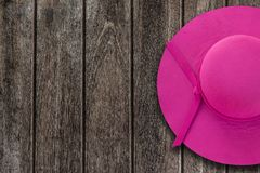 Pink summer hat on wooden table stock photo