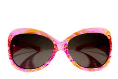 Pink Sunglasses. Isolated plastic pink girls sunglasses with dark lenses Royalty Free Stock Image