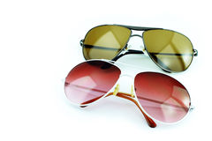 Pink sunglasses and black sunglasses. On white background Royalty Free Stock Images