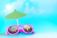 Pink Sunglasses reflection sunset at palm tree landscape scene w Stock Image