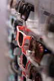 Pink Sunglasses. Row of sunglasses with retro style pink sunglasses sticking out Stock Photo