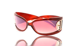 Pink sunglasses on white. Beautiful pink glasses on a white background Royalty Free Stock Photo
