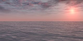 Pink Sunrise. Over the ocean. Soft Sunlight. Calm weather Royalty Free Stock Image