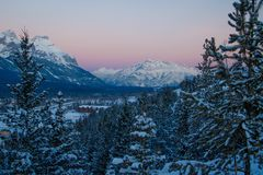 Pink sunrise color above Cascade mountain in Canadain Rockies. Morning view of canadian mountains in Banff natonal park, frozen beauty, beautiful freezing cold stock photos