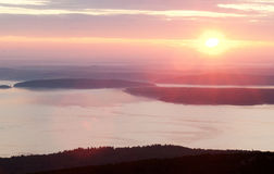 Pink sunrise in mountain and sea shore Stock Photography