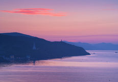 Pink sunrise in mountains. On the coast Stock Photo