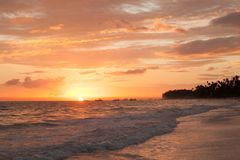 Pink sunrise over Atlantic Ocean. Bavaro beach. Hispaniola Island. Dominican Republic, coastal landscape Stock Photos