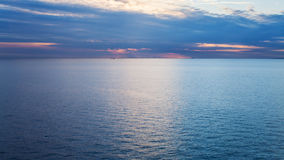 Pink sunrise over calm blue Baltic Sea in autumn Royalty Free Stock Image
