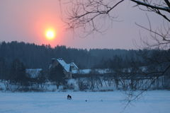 Pink Sunrise Over Frozen Lake. Royalty Free Stock Photo