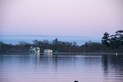 Pink sunrise. Viewed across the still waters of a lake Stock Photo