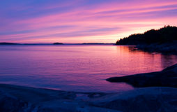 Pink sunset. Pink sunset in the archipelago of Stockholm royalty free stock image