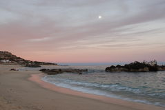 Pink sunset. On a beach in Palmilla, Mexico stock photos