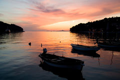 Pink Sunset. Sunset over Cavtat Bay with small boats in the foreground royalty free stock images