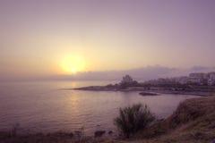 Pink sunset in Alghero Stock Image