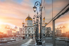 Pink sunset at the Cathedral of Christ the Savior. With a string of lanterns Stock Photos