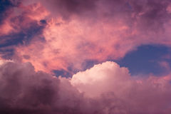 Pink Sunset Clouds. Mix of clouds colored pink at sunset after a rainy day Royalty Free Stock Photo