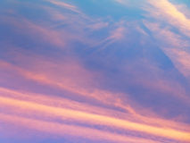 Pink sunset clouds in blue evening sky Stock Photo