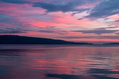 Pink sunset on a cloudy evening Stock Photo
