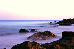 Pink Sunset colors on the rocky coastline of Maine Stock Photography