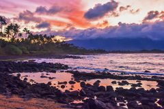 Pink Sunset with Dramatic sky in Maui Hawaii stock photography