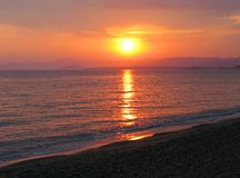 Pink sunset in mediterranean sea Stock Images