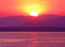 Pink sunset in mediterranean sea Stock Photo