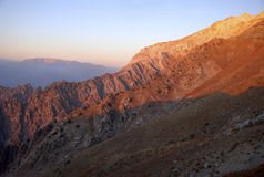 Pink sunset in the mountains of Tien Shan Stock Photos