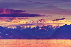Pink sunset over Alps and Lake Geneva. Switzerland Stock Photos
