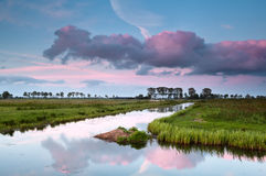 Pink sunset over water canal Royalty Free Stock Image