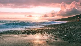 Pink sunset on the sea stock photography