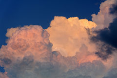 Pink Sunset Storm Clouds. Dramatic pink sunset storm clouds with dark blue sky royalty free stock images