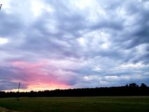 Pink sky at night... Pink sunset before storm royalty free stock images