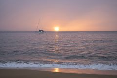 Pink Sunset or Sunrise Sky over Calm Ocean with Reflection on Ho royalty free stock image