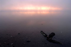 Pink surise on a misty river. Early in the morning Stock Photo