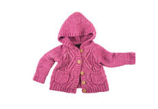 Pink sweater. Baby warm knitted woolen pink sweater with buttons and hood Stock Photos