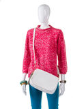 Pink sweater and white purse. Royalty Free Stock Image