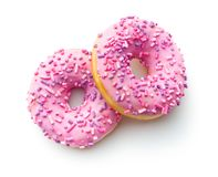 Pink sweet donuts. Two pink sweet donuts isolated on white background stock images