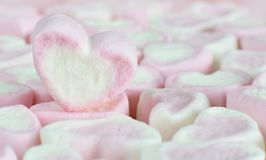 Pink sweet marshmallow heart closed up. Background to valentines day Royalty Free Stock Photo