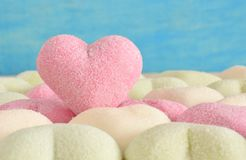 Pink sweet marshmallow heart with sugar. Pink sweet marshmallow candy in heart shape coated with sugar Royalty Free Stock Images
