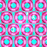 Pink Swim Rings On Water For Background Royalty Free Stock Photography