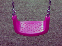 Pink swing on green grasses Stock Images