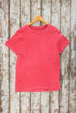 Pink t-shirt on hanger Royalty Free Stock Photos