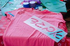 Pink T-shirt templates with letters Aleph Bet Gimel Dalet in Hebrew for drawing on a table Royalty Free Stock Photo